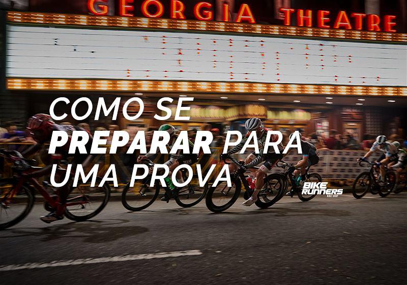 Banner com vários ciclistas em suas bicicletas em competição correndo em avenida passando em frente teatro de Georgia e em primeiro plano as escritas Como se preparar para uma prova