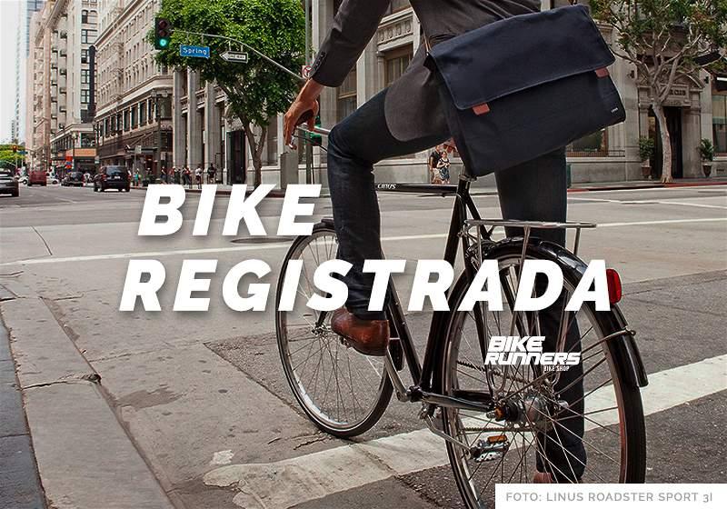 """Banner com pessoa andando de bicicleta em rua e a escrita """"Bike Registrada"""""""